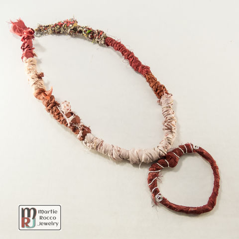 Knotted,fabric,necklace,with,red,heart,pendant