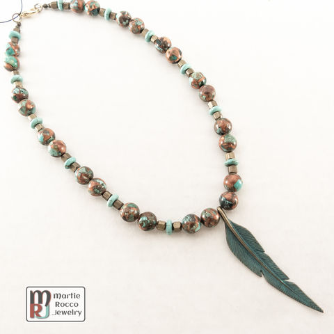 Turquoise,and,brass,necklace,with,patina,feather,pendant,Turquoise and brass necklace with patina feather pendant