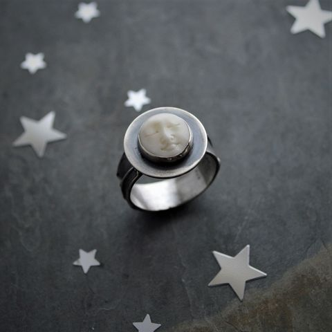 Moon,Face,Ring,,Carved,Bone,and,Sterling,Silver,,Size,8,moon ring, moon face jewelry, sterling silver moon ring, size 8 ring, carved bone moon, artisan made ring, plant textured band ring, celestial ring, gayle dowell, space ring