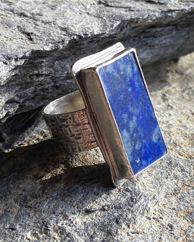 Sterling,Silver,Lapis,Lazuli,Ring,with,Iron,Pyrite,lapis ring	lapis lazuli	lapis lazuli ring	statement ring	lapis statement ring	iron pyrite	fools gold	wide band wing	textured band ring	textured ring	textured band	steph stargell	boho ring