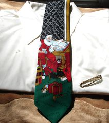Christmas,Tie,With,Santa,Checking,His,List,Twice,By,Yule,TieGreetings,tie, mens tie, Christmas, Santa, Checking his list twice, Yule Tie Greetings, red, green, black, white, gold, drum, presents, cats, toy horn, teddy bear, toy drum, candy canes. Two Artisan Sisters