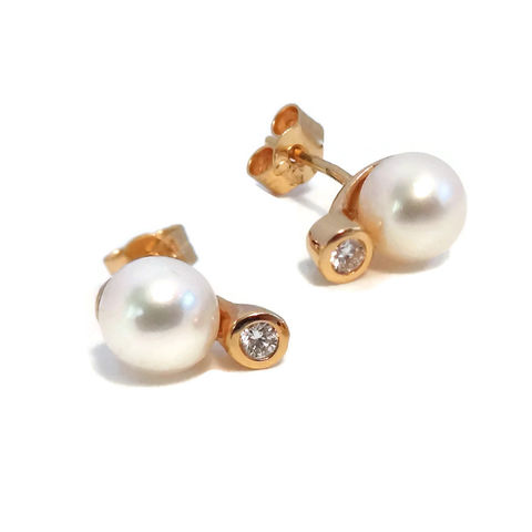 18 carat yellow gold pearl and diamond stud earrings.