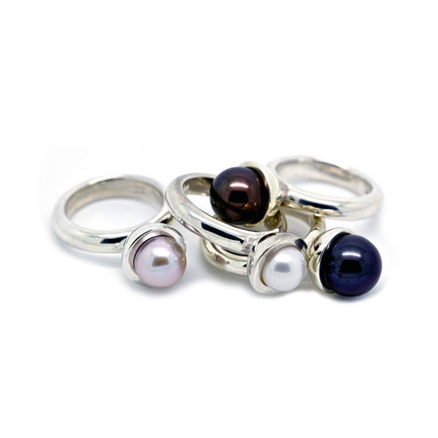 Polished pearl cup rings in sterling silver with south sea pearls.