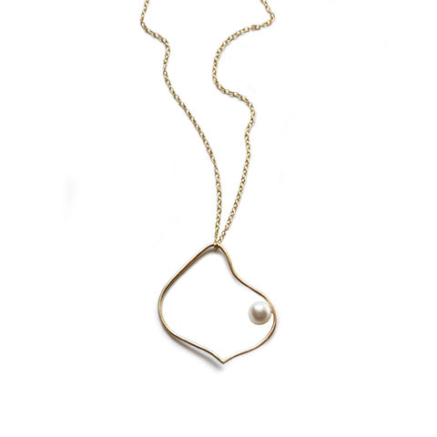 Silhouette,solid,gold,arabesque,necklace,with,white,pearl,by,Katerina,Damilos,Katerina Damilos, jedeco, solid gold and pearl necklace, asymmetric gold pendant, 9ct gold and pearl pendant necklace, modern pearl, day to evening jewellery