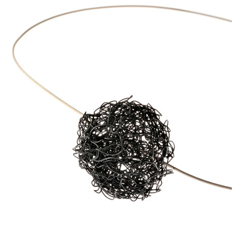 HANDKNIT,black,necklet,by,Danny,Ries,Danny Ries, gold hand-knitted ball pendant
