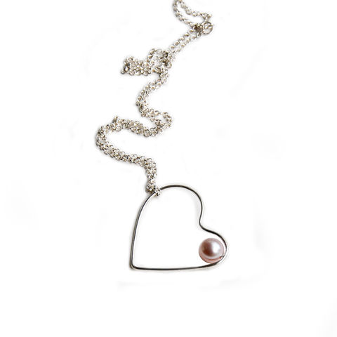 Silhouette,silver,hoop,necklace,with,blush,pearl,by,Katerina,Damilos,Katerina Damilos, jedeco, silver heart and pearl necklace, asymmetric silver heart pendant, modern pearl, day to evening jewellery