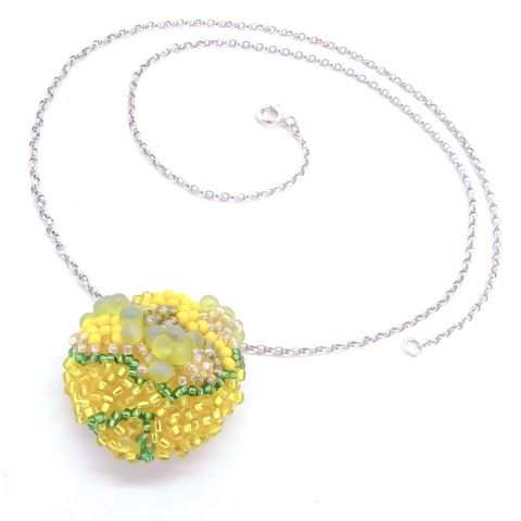 Organic,beaded,yellow,necklace,by,Dani,Crompton,organic silver necklace with purple beads