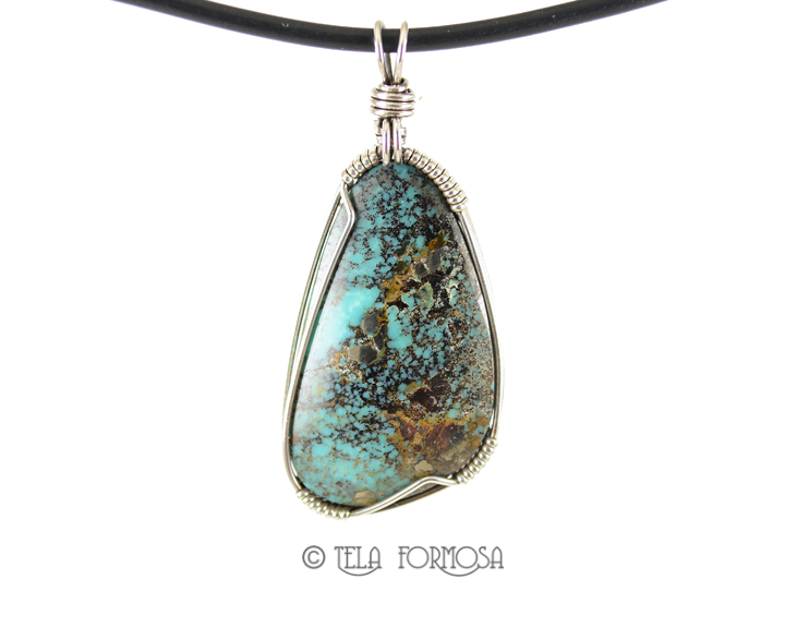 Natural untreated Kingman turquoise pendant wire wrapped in sterling silver