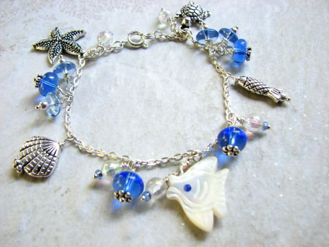 Ocean,Charm,Bracelet,Blue,Silver,Hand-crafted,Jewelry,charms, starfish, mother of pearl, shell, fish, angel fish, turtle, playful, ocean, sea life, bracelet, beaded, dangly, 7 inch, wire wrapped, bead clusters, bits off the beach,
