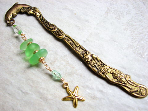 Sea,Glass,Bookmark,with,Dolphin,and,Starfish,Charm,dolphin bookmark, sea life, gold, beach glass, green and gold, white, dangle, metal, shepards hook, sea glass, seaglass, starfish charm, beach glass book mark, teachers gift, graduation gift, ocean, nautical bookmark, beaded, starfish bookmark, sea glass