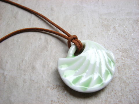 Porcelain,Shell,Shape,Pendant,,Mint,Green,on,Leather,Necklace,glazed porcelain pendant, glass shell pendant, pendant necklace, mint green, 19 inch leather necklace, tan leather, copper closures, minimalist, beachy, shell shaped necklace, green swirls, light green jewelry, simple jewelry, boho style
