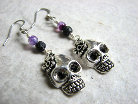 Lady,Skull,Halloween,Earrings,with,Lava,and,Amethyst,skull earrings, scull earrings, gemstone skull, amethyst Halloween earrings, Lava Halloween Earrings, Female skull charm, spooky skull earring, big tooth grin skull, flower skull, purple and black, Halloween earrings, Halloween jewelry, dangle, 2 inch lon