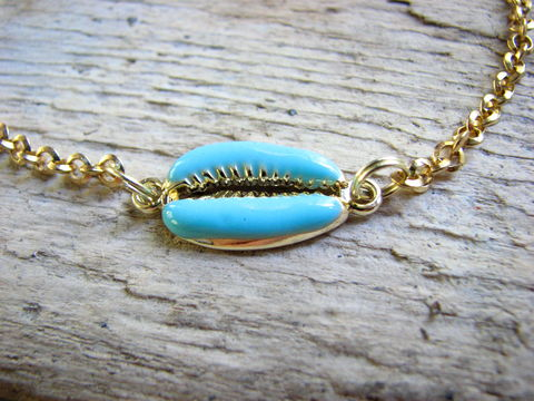 Adjustable,Gold,Chain,and,Blue,Cowrie,Shell,Ankle,Bracelet,cowrie shell anklet, gold sea shell charm, blue and gold cowrie charm, gold chain anklet, cowrie anklet, turquoise blue and gold, beach ankle bracelet, mermaids ankle bracelet, sleek ocean jewelry, womens beach anklet, sea shell ankle bracelet, blue seali