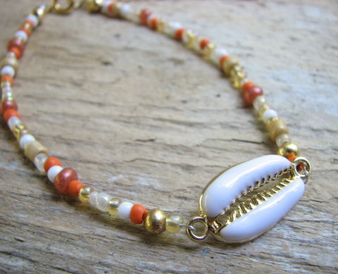 Beaded,White,Cowrie,Shell,Charm,Anklet,Bracelet,white cowrie charm, shell anklet, sea shell ankle bracelet, beaded ankle jewelry, orange beaded jewelry, gold beaded anklet bracelet, ocean life jewelry, colorful shell jewelry, gold bead ankle bracelet, tropical beach jewelry, vacation accessory, womens