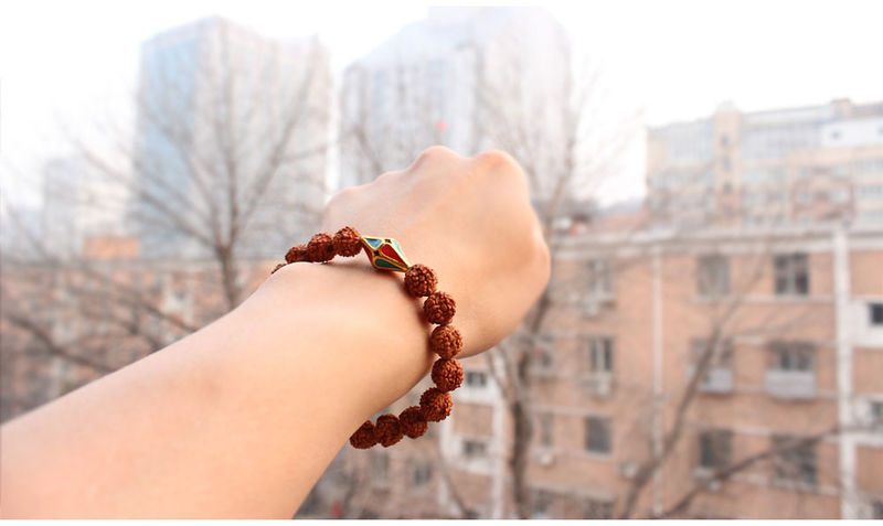 Rudraksha Bracelet with Tibetan Guru Bead - product images  of