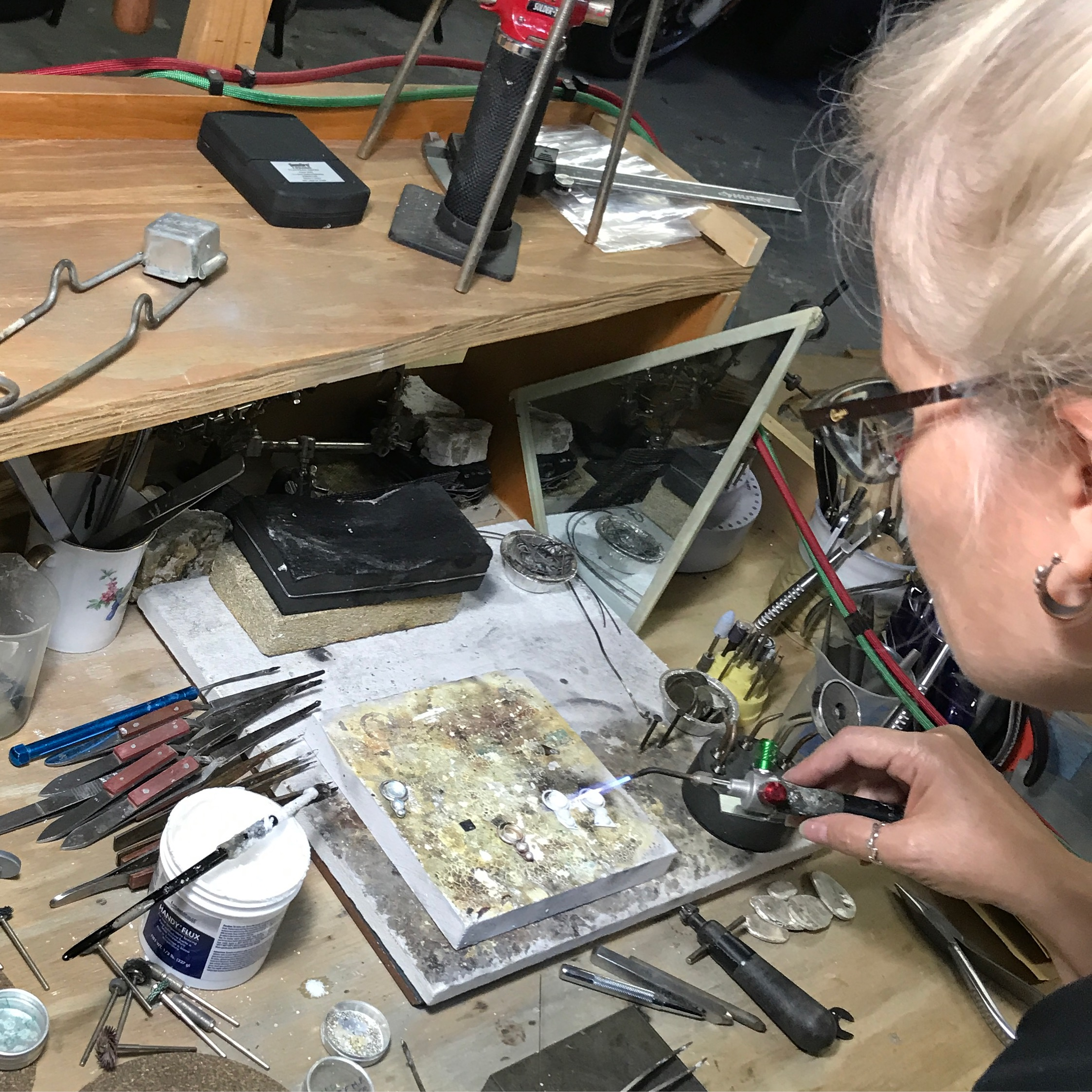 MosaicSmith artisan Linda Pieroth Smith at work in her shop.