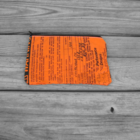 Zipper,Pouch,:,Two,Orange,Warning,Labels,with,Gray,and,Neon,Green,Parachute,Lining,parachute logo, zipper pouch, warning label