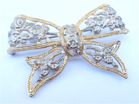 Vintage,Rose,Flower,Silver,Tone,Brooch,Two,Gold,Trim,Ribbon,Pin,Lace,Cut,Off,Bow,Perforated,Filigree,Rosette,Scarf,Hat,Beret,Lapel,vintage rose flower silver tone brooch, vintage gold silver tone bow ribbon brooch, vintage rose bud silver ribbon brooch, vintage silver lace like roses brooch, vintage two tone lace bow brooch, vintage silver rosette floret brooch, gold trim bow pin