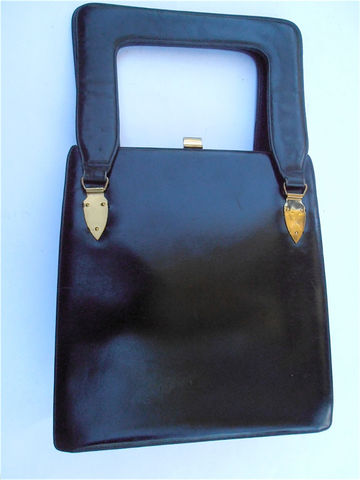 Vintage,Black,Leather,Handbag,Koro,Collection,Mid,Century,Hard,Case,Structured,Avant,Garde,Bag,Side,Gold,Tone,Accents,vintage black leather koro bag, vintage black leather koro handbag, koro collection bag, mid century handbag, vintage black hard case bag, black structured bag, vintage avant garde handbag, hard sided purse, brass black handbag, genuine leather bag