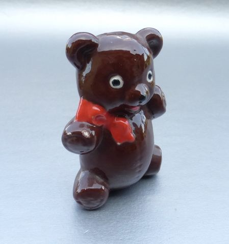 Dark,Brown,Shiny,Ceramic,Figurine,Sculpture,Red,Ribbon,Scarf,Nursery,Decoration,Curio,Display,Cub,Home,Decor,Figure,Glazed,Big,Saucer,Eyes,Collectible,Collection,Pottery,dark brown teddy bear glazed figurine, shiny brown bear cub figurine, nursery baby bear decor, brown teddy bear cub figure, brown teddy bear sculpture, saucer eyes bear, red lips bear, red ribbon scarf teddy bear cub