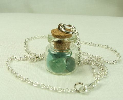 Glass,Jar,Pendant,filled,with,gemstone,chips,in,greens,browns,and,blues,on,18,inch,chain,womens necklace, pendant necklace, glass bottle pendant, cork top pendant, jar pendant, gemstone chips, jar necklace, jar jewelry, bottle jewelry, gift for her, glass jar necklace, green gemstone necklace