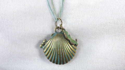 Shell,pendant,with,mermaid,necklace,art,locket,button,shells,verdigris,jewelry,double,chains,mermaid art pendant, seashell locket, shell art locket on long green chain, ocean jewelry, mermaid necklace, verdigris jewelry, double chains art pendant