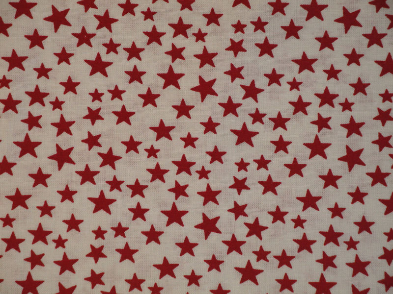 Scattered Star Fabric White With Red Star Sold By The Yard - product image