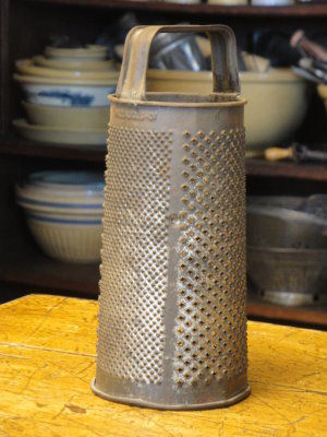 Antique Round Grater Dated - product image
