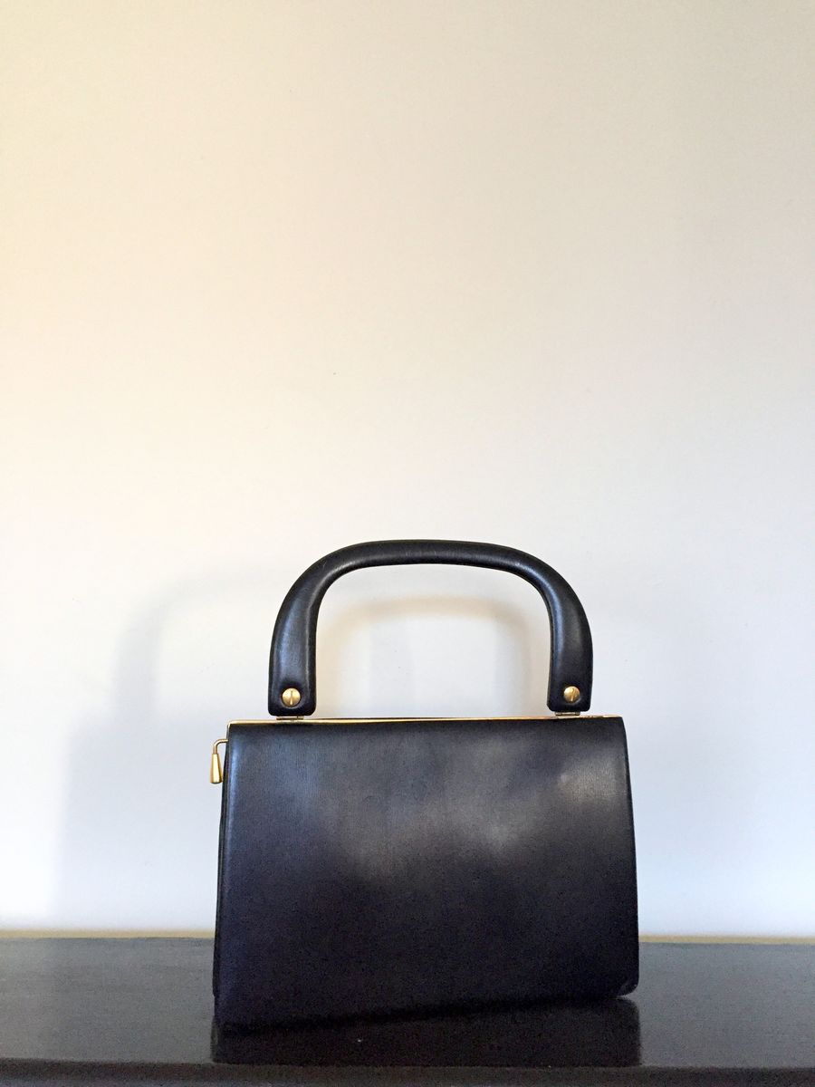 Vintage Black Leather Handbag with Brass Trim and Red Lining - product image