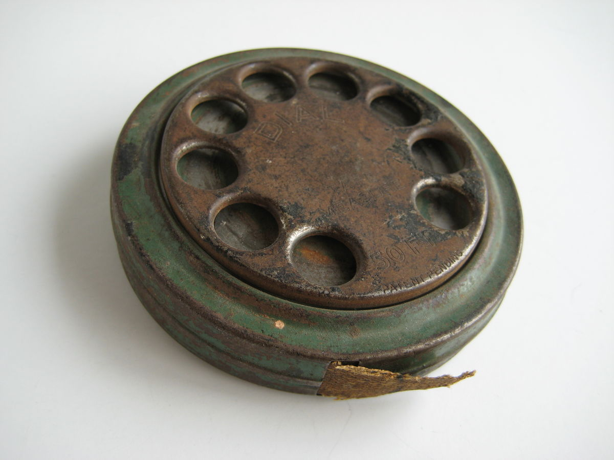 Antique Dial Tape Measure - product image