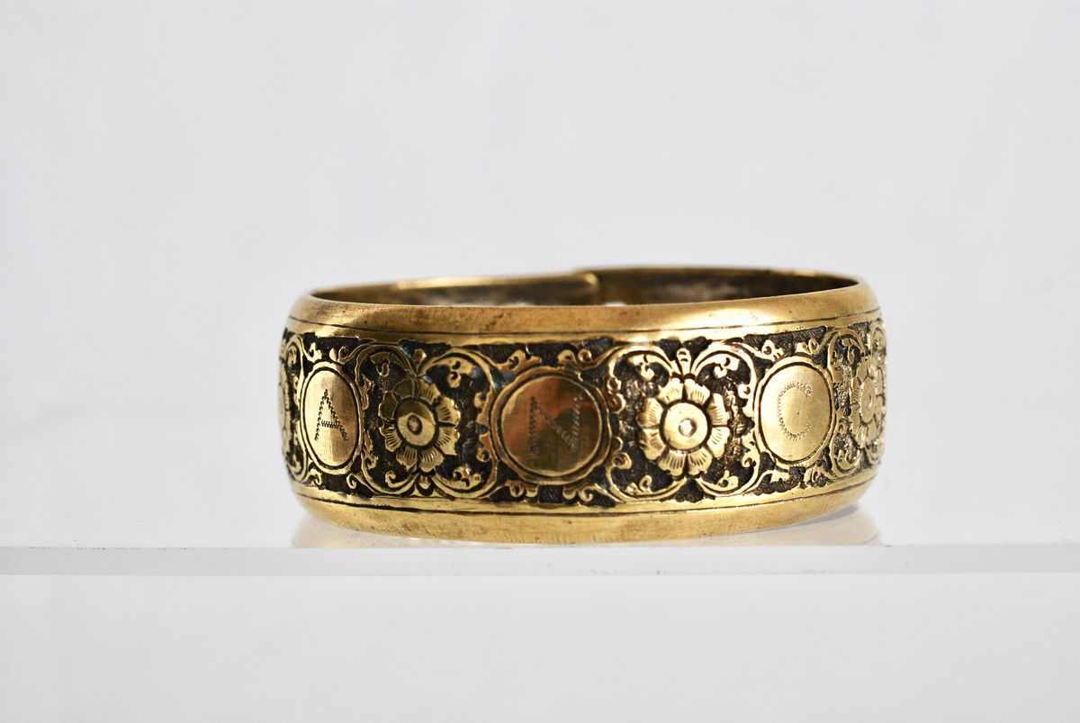 1920's Brass Engraved Bangle with Flowers and Elephants - product image
