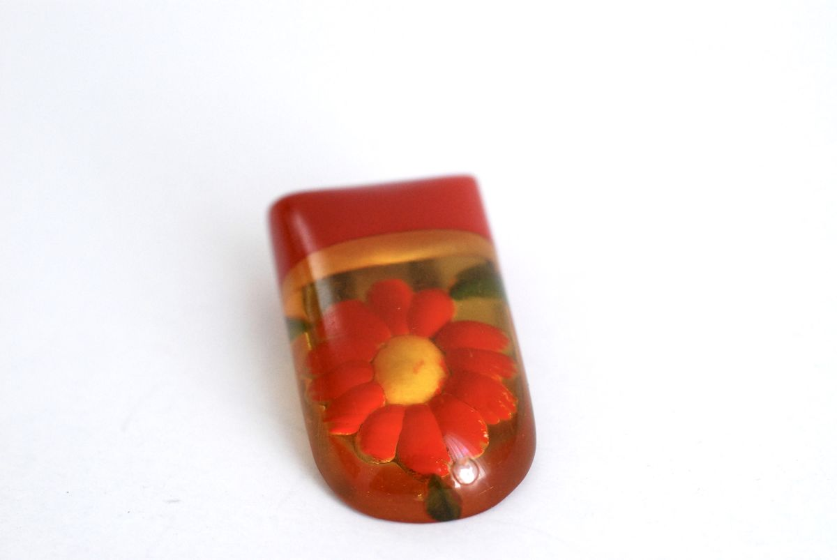 Bakelite Dress Clip Apple Juice Reverse Carved Red Flower - product image