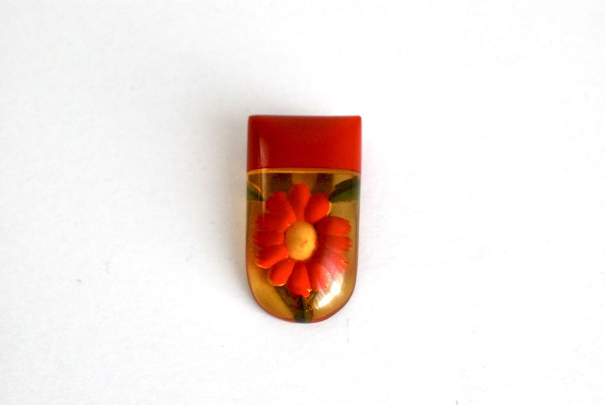 Bakelite Dress Clip Apple Juice Reverse Carved Red Flower - product images  of