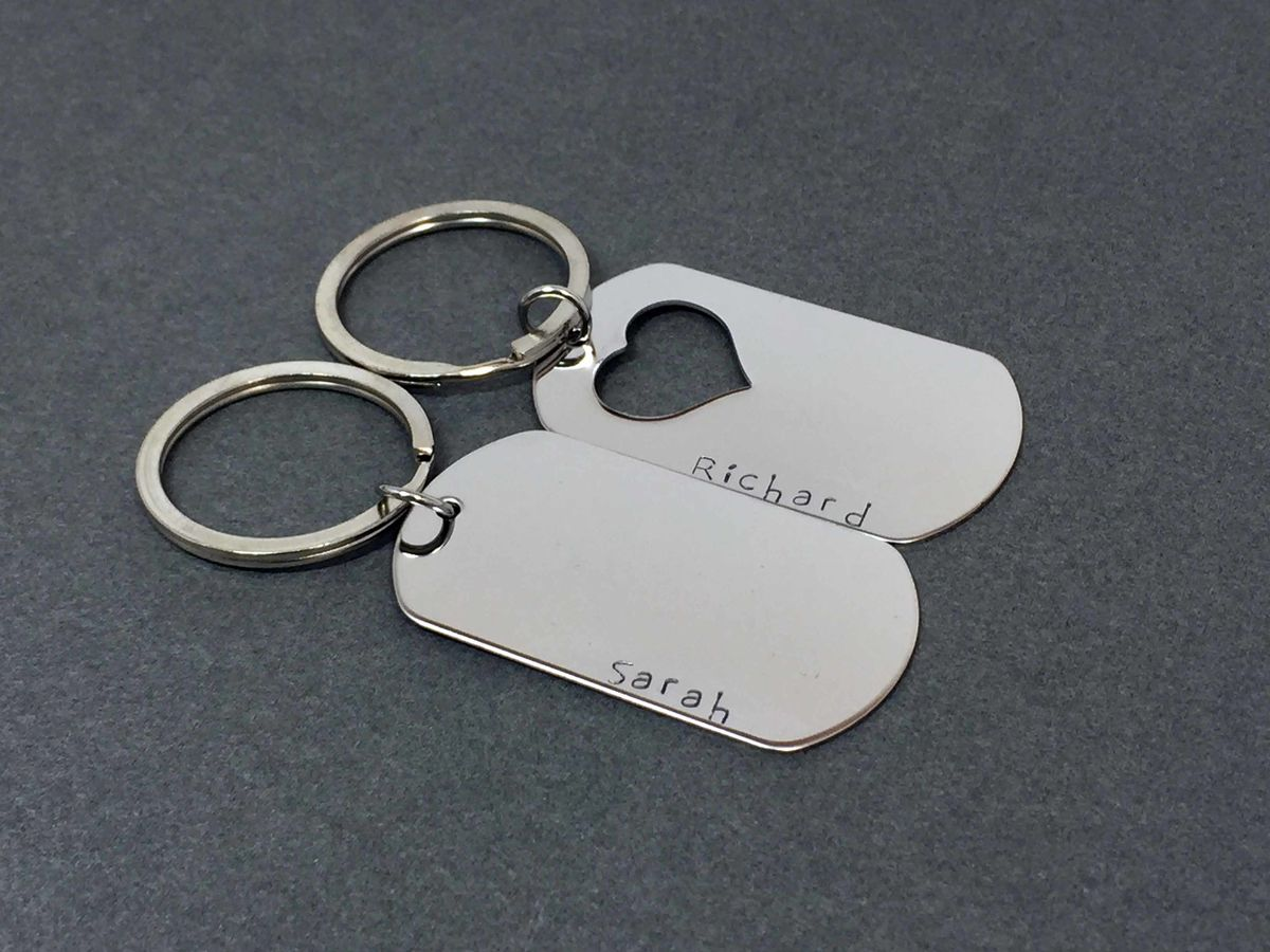 Set of Dog Tag Keychains with Heart Cut out and custom names - product image