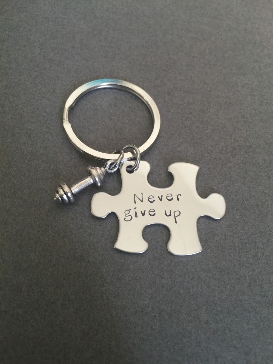 Never Give Up puzzle keychains with dumbbell charm - product image