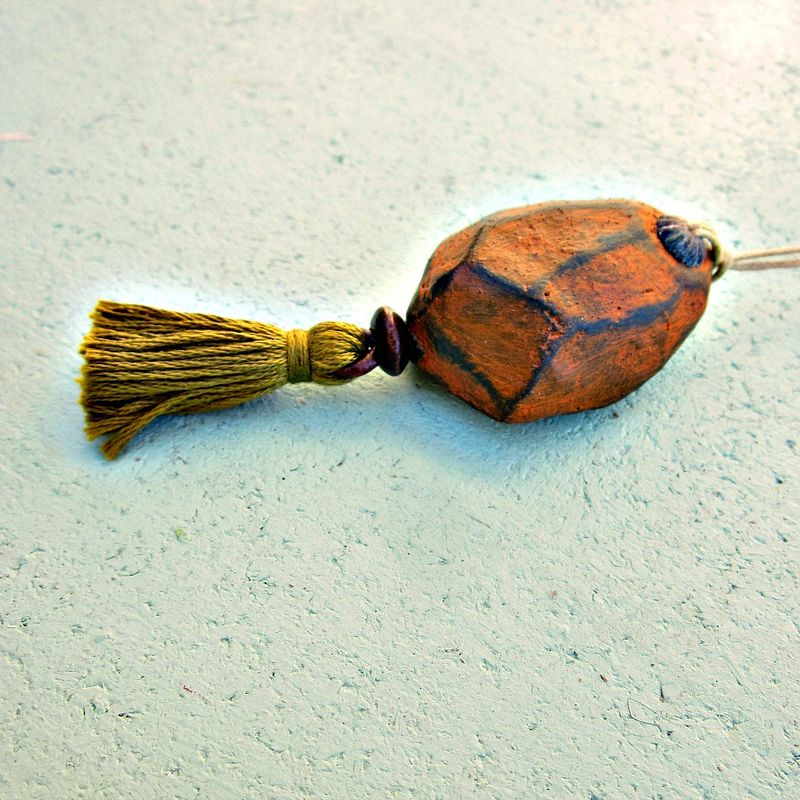 Faceted Orange Paper Mache Ornament with Green Tassel - product images  of