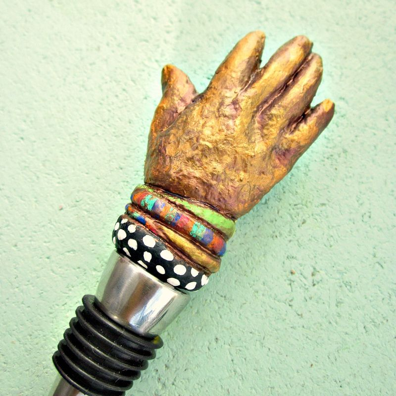 Bottlestopper with Sculpted Decorative Paper Mache Hand with Bracelets Top: Hands Up for Wine - product images  of