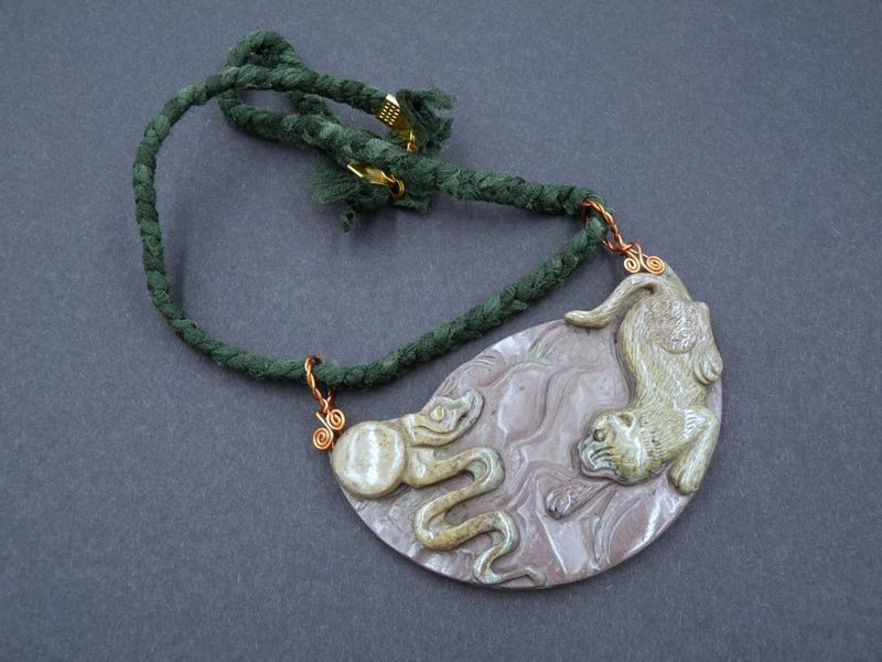 Carved Jasper playful Cat necklace - product image