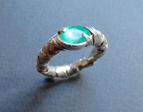 WOVEN,ring,encased,with,oval,emerald,Woven ring, woven jewellery, sculptural jewellery