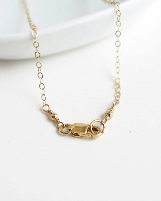 Gold Fill Baby Footprints Necklace with April Birthstone - product image
