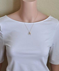 Small Gold Filled Cross Necklace with Birthstone for April - product images 4 of 6
