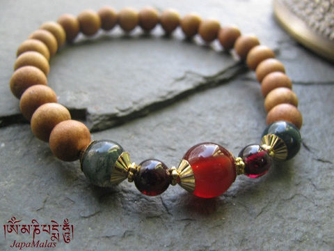 Sandalwood,Bracelet,Mala,with,capped,carnelian,guru,bead,purified,&,blessed,mala,Jewelry,Beadwork,sandalwood,japa_mala_bead,hindu,buddhist_mala,meditation,yoga,zen,prayer_beads,worry_beads,yoga_jewelry,bracelet,christmas_in_july,sandal wood beads,mantras,pure intention,elastic cord