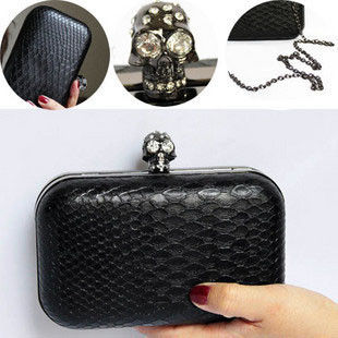 CRYSTAL SKULL SNAKE SKIN CLUTCH BAG - product image