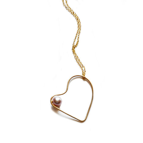 Silhouette,solid,gold,heart,necklace,with,blush,pearl,Katerina Damilos, 9ct gold jewellery, June birthstone, 9ct gold and pearl necklace, asymmetric solid gold pendant, 9ct gold and pearl pendant necklace, modern pearl, day to evening jewellery