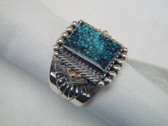 High Grade Spider Web Turquoise set in Sterling Silver with Gold Accents - product images  of