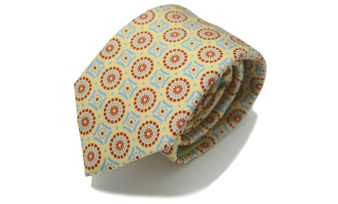 LEOPOLD,yellow silk tie, geometric silk tie, mens silk ties uk, mens silk ties online, silk ties online, red yellow blue tie, yellow necktie, patterned silk tie, printed silk tie