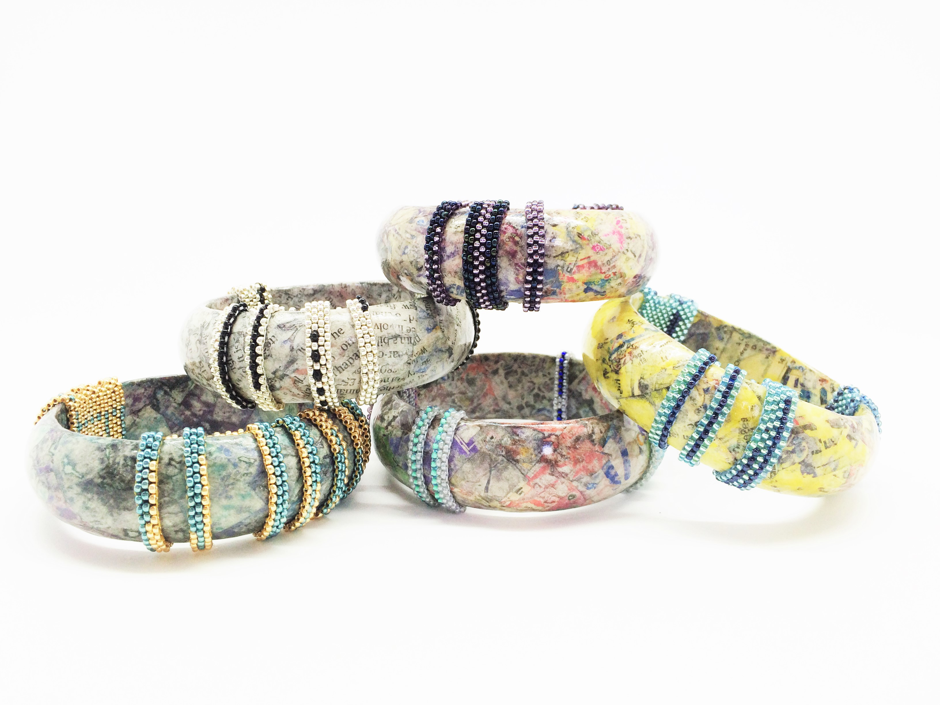 Urchin bangles in paper and bead work by Danii Crompton Designs