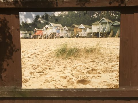 Sandy,Beach,Huts,outdoor pictures, wood prints, outdoor art, outdoor images, prints for outdoors, garden pictures, conservatory pictures, photo art pictures, beach huts picture, wells-next-the-sea print, outdoor prints, outdoor wood prints