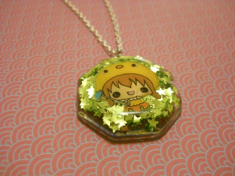 Sparkly,Green,Stars,with,Kawaii,Fairy,Octogan,Necklace,Super kawaii octogan shaped resin pendant filled with super sparkly light green star glitter. The pendant also features a cute yellow kawaii fairy girl giggling on the front of the necklace. silver gold necklace chain cute pendant