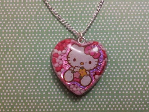 100s,and,1000s,Love,Sweetheart,Hello,Kitty,Necklace,Sweetheart-shaped resin necklace pendant filled with red, pink and white 100s and 1000s and also featuring a cute Hello Kitty image. pendant silver gold necklace chain cute pendant